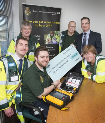 From left, members of Tadley First Responders, Greg Britton, Scott Schimmen, Ben England, Andy Walters and Debbie Leadbetter are presented the cheque for £18,000 by AWE Deputy Managing Director Rob Fletcher.